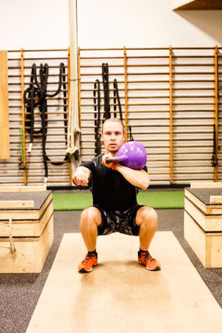 Squat with one arm kb in rack position